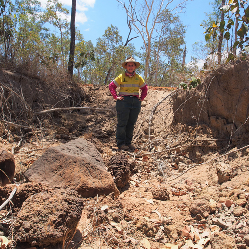 Terrain's Jen Mackenzie at an eroded gully on Glen Ruth Station